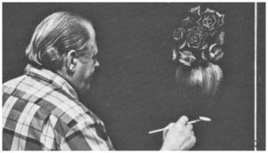 bill at the easel painting a vase of roses on a black canvas