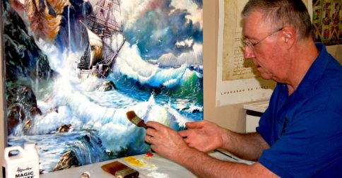 Tom Anderson at work on a large seascape.